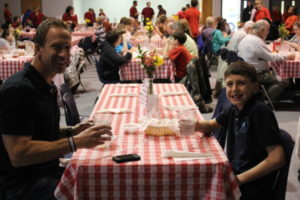 8th Grade students (and their parents) serve the school at the Spaghetti Dinner.