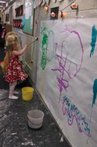 Only in Preschool are you encouraged to paint on the wall!